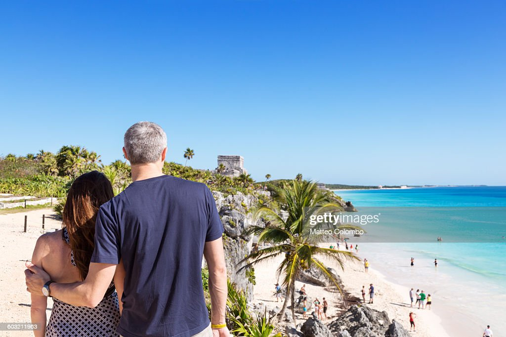 Tourist couple in the mayan ruins of Tulum, Mexico : Stock Photo