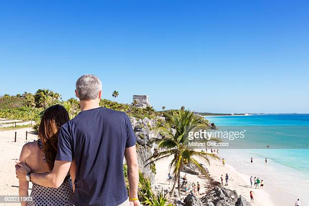 tourist couple in the mayan ruins of tulum, mexico - quintana roo stock pictures, royalty-free photos & images