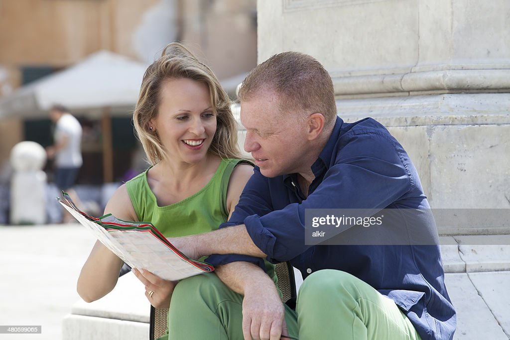 tourist couple looking at map : Stock Photo