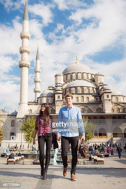 Tourist couple outside the Blue Mosque in Istanbul, Turkey