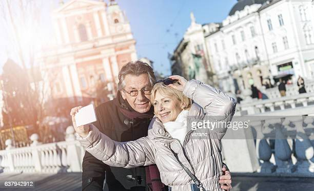 Tourist couple taking a selfie in Ljubljana, Slovenia