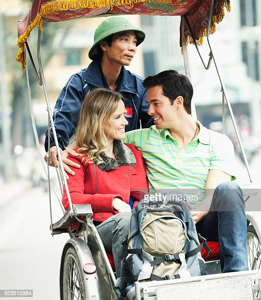 tourist couple travelling in vietnam - hugh sitton stock pictures, royalty-free photos & images