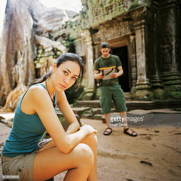 tourist couple with map at temple - hugh sitton stock pictures, royalty-free photos & images