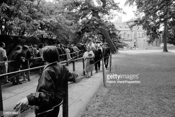 Tourist crowds queueing up to enter Woburn Abbey and its Gardens in Bedfordshire, circa July 1969. From a series of images to illustrate the many...