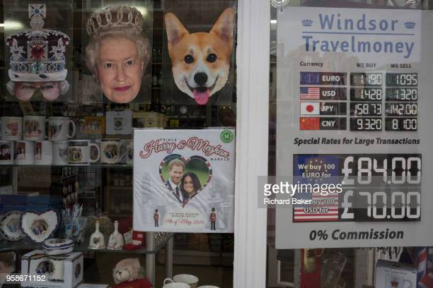 Tourist currency rates and royal family souvenirs and merchandise on sale in a tourist gift shop window as the royal town of Windsor gets ready for...