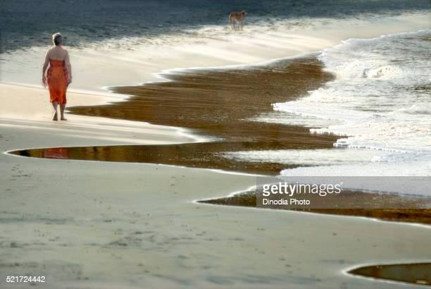 Tourist dawn walk in the beach at Kovalam, kerala, India