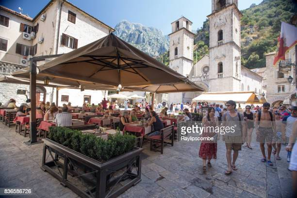 Tourist dining in the beautiful Adriatic coastal town of Kotor in Montenegro
