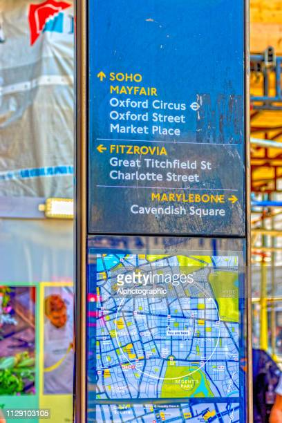 tourist directional sign - bokeh museum stock photos and pictures