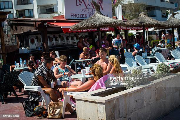 Tourist enjoy drinks at a bar terrace at Magaluf beach on July 12 2014 in Mallorca Spain Magaluf is one of the Britain's favorite holiday...