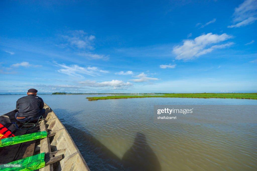 Tourist enjoying a morning view of lake Thale Noi, Phatthalung, Thailand. : Stock Photo