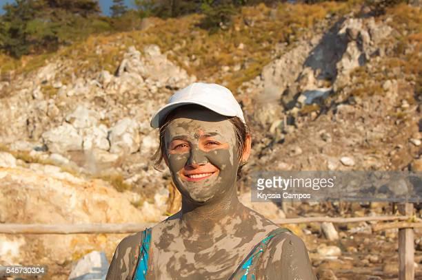 Tourist enjoying hot springs and mudbaths in Costa Rica