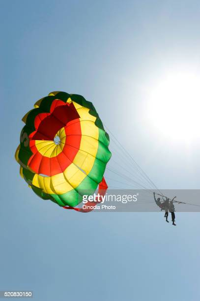Tourist enjoying parachute ride at colva beach, Goa, India