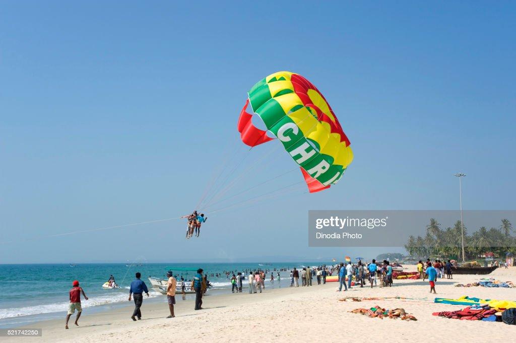 Tourist enjoying parachute ride at colva beach, Goa, India : Stock Photo