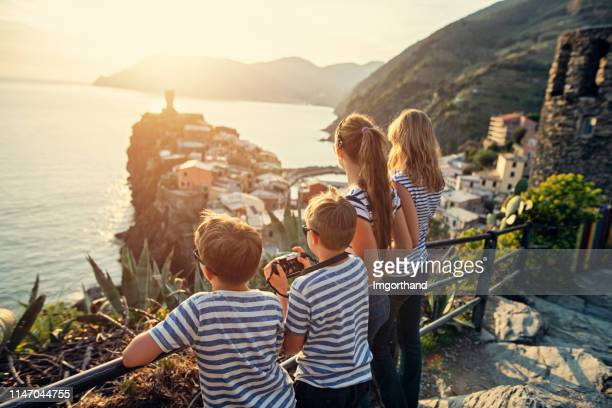 tourist enjoying sunset in vernazza, cinque terre, italy - unesco world heritage site stock pictures, royalty-free photos & images