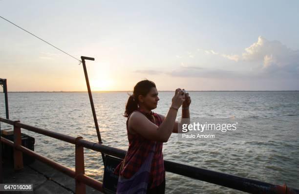 A Tourist Enjoying the Sunset in Amazon,Brazil