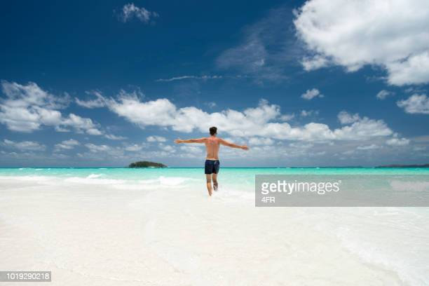 tourist enjoying the white beaches, whitsunday islands, queensland, australia - whitsunday island stock photos and pictures