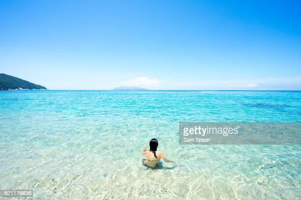 Tourist enjoying tropical beach paradise in Yakushima Island, Japan