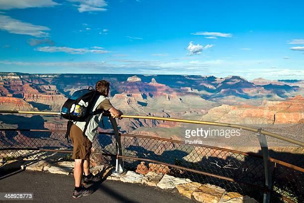 Tourist Enjoying View of Grand Canyon Arizona USA