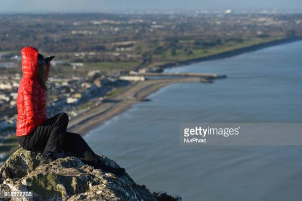 A tourist enjoys a general view of Bray beach and cost line from the Bray Head On Thursday February 15 Dublin Ireland