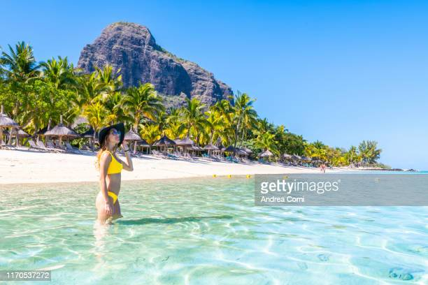 a tourist enjoys the sun in a tropical beach - indian ocean stock pictures, royalty-free photos & images