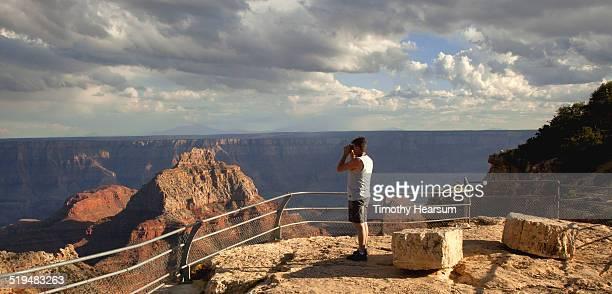 tourist enjoys view of grand canyon, north rim - timothy hearsum fotografías e imágenes de stock