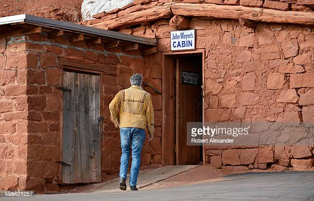 A tourist enters 'John Wayne's Cabin' at the historic Goulding's Trading Post near Monument Valley Navajo Tribal Park in southeastern Utah The stone...