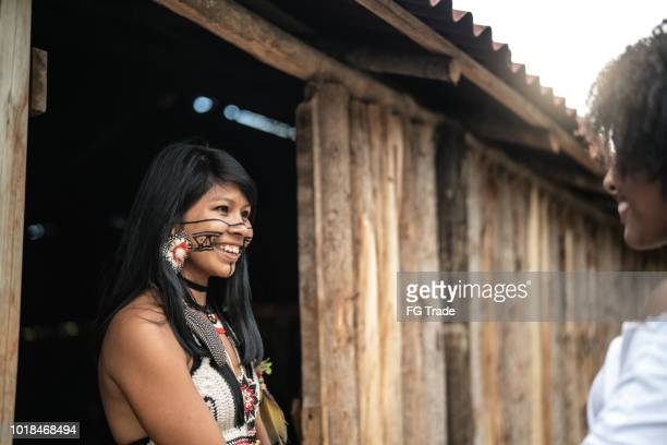 tourist experiencing a new visit in tupi guarani indigenous village - manaus stock pictures, royalty-free photos & images