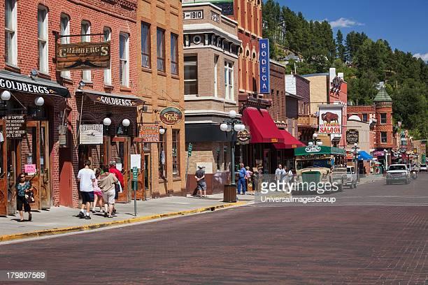 Tourist explore Main Street in historic Deadwood South Dakota