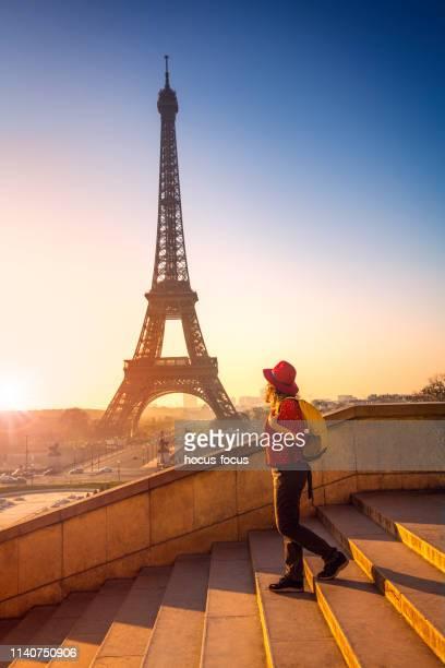 tourist exploring eiffel tower paris france - paris france stock pictures, royalty-free photos & images