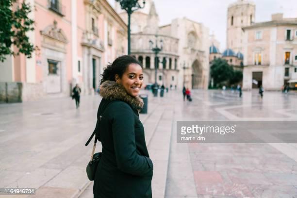 tourist exploring europe,plaza de la virgen,valencia - black square stock pictures, royalty-free photos & images