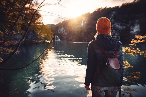 Tourist exploring Plitvice Lakes National Park 1051781280