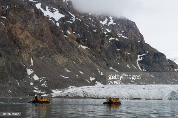 Tourist exploring the Krossfjorden, Spitsbergen, Svalbard Islands, Norway..
