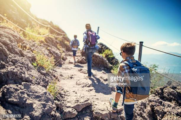 tourist family hiking on mount vesuvius volcano in campania, italy - mt vesuvius stock pictures, royalty-free photos & images