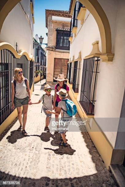 tourist family sightseeing ronda, spain - costa del sol stock photos and pictures