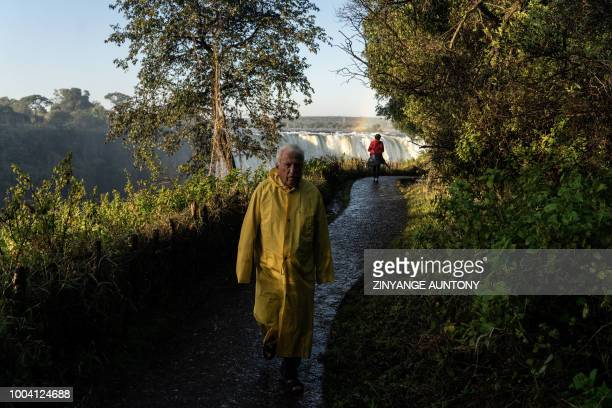 A tourist follows a path in the Victoria Falls rainforest on June 29 2108 in the resort town of Victoria Falls After nearly two decades in the...