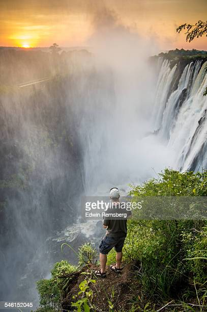 tourist gazing at victoria falls - victoria falls stock pictures, royalty-free photos & images