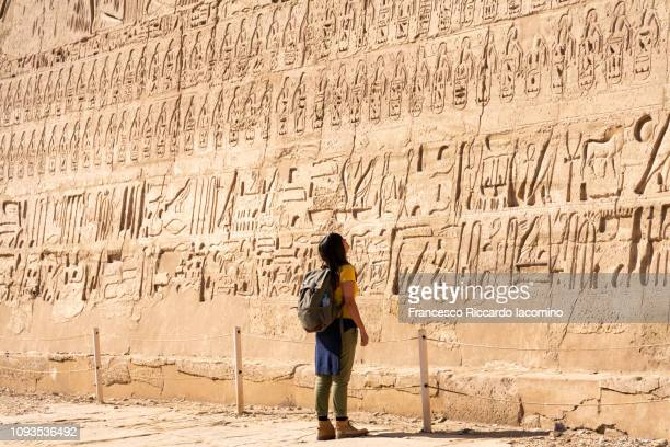tourist girl admiring medinet habu temple, luxor - ancient civilization stock photos and pictures