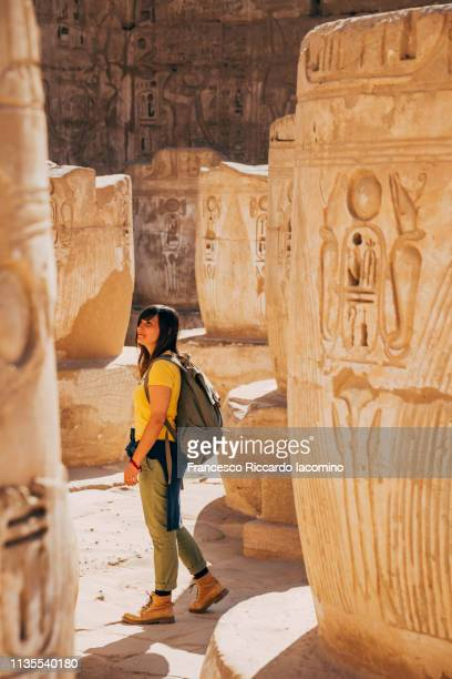 Tourist girl at Medinet Habu Temple