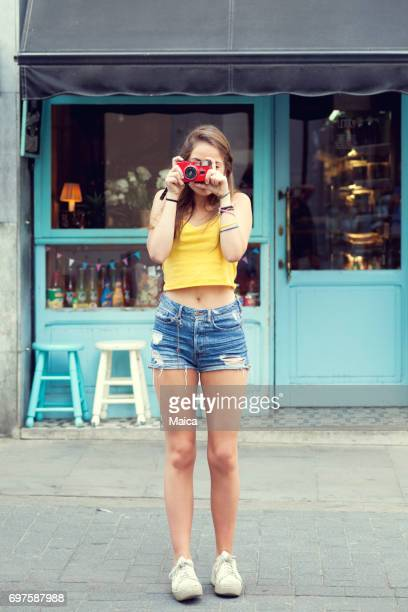 tourist girl with vintage camera - camera girls stock photos and pictures