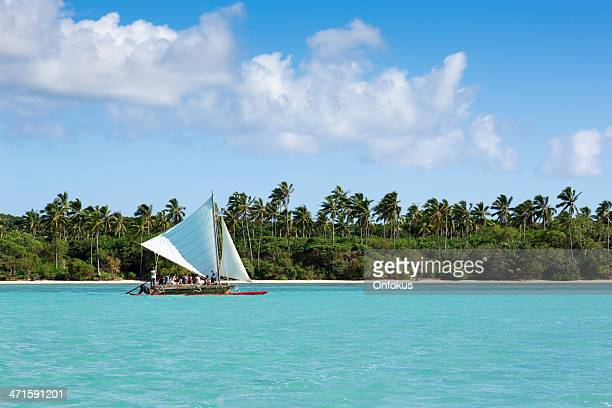 tourist group on dugout canoe, isle of pines, new caledonia - new caledonia stock photos and pictures