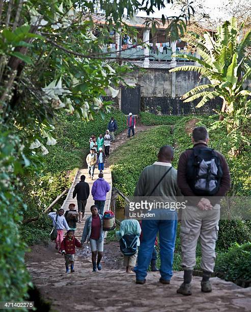 tourist, guide and local people; andasibe, madagascar - eastern african tribal culture stock photos and pictures