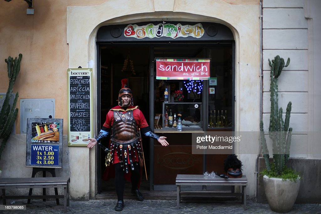 A tourist guide dressed as a Roman Centurion stands in a cafe on Piazza di Pietra on March 16, 2013 in Rome, Italy. Rome is preparing for the inauguration of Pope Francis on March 19, 2013 in St Peter's Square.