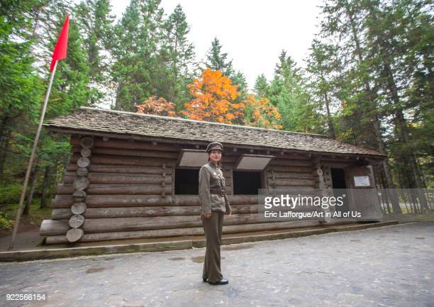 Tourist guide in front of a log cabin in the secret camp no1 hq of the Korean people's army Ryanggang Province Samjiyon North Korea on September 18...
