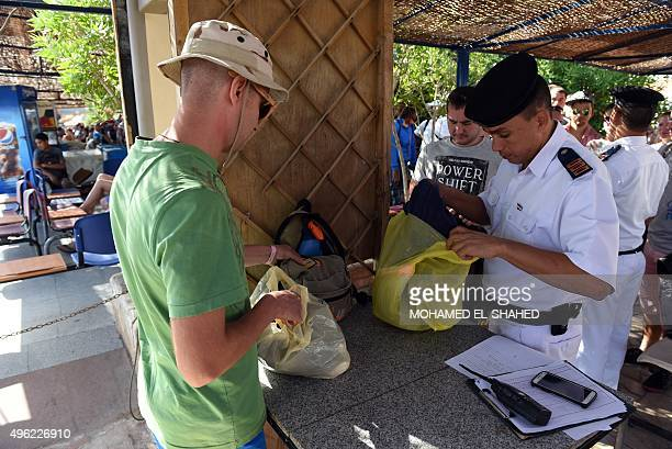 A tourist has his belongings checked by Egyptian security forces in the Red Sea resort of Sharm elSheikh on November 8 2015 Moscow and London ramped...