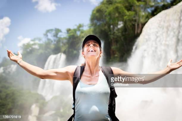 tourist having fun in iguazu falls - iguacu falls stock pictures, royalty-free photos & images