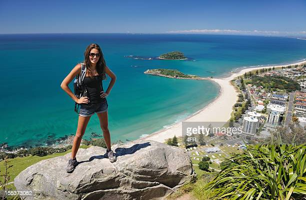 tourist hiker overlooking mt. maunganui, bay of plenty, new zealand - mount maunganui stock photos and pictures