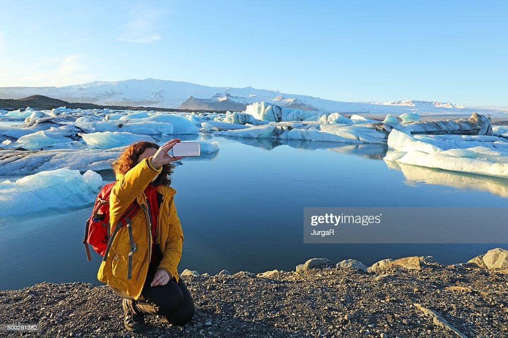 Tourist Hiker Taking Selfie at Jokulsarlon Glacial Lagoon in Iceland : Stock Photo