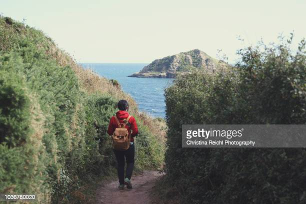 Tourist hiking along the Cornwall Coast