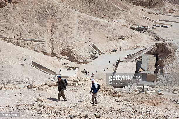 Tourist hiking on Hill of Valley of the Kings, Luxor, Egypt