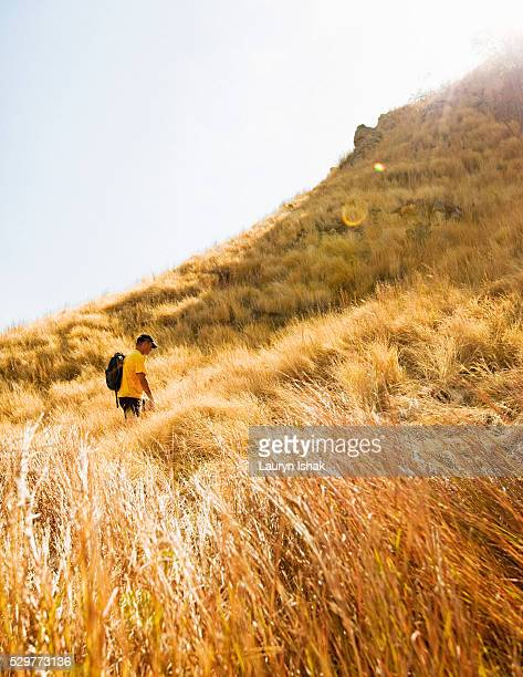 Tourist hiking up hill on Kelor Island in Komodo National Park